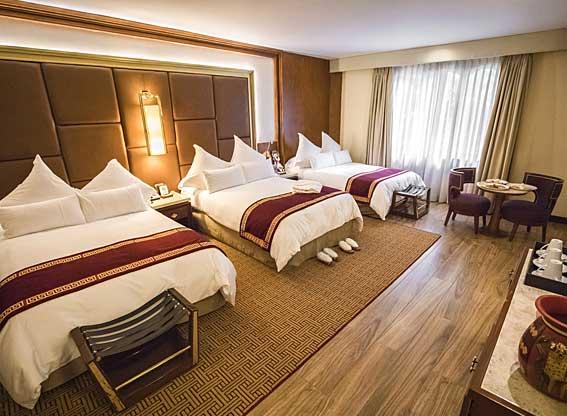 Samaq Hotel Deluxe Bedroom